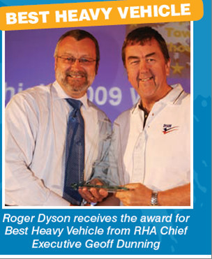 Roger accepting the best heavy vehicle award. -Tow Show a success for Roger Dyson